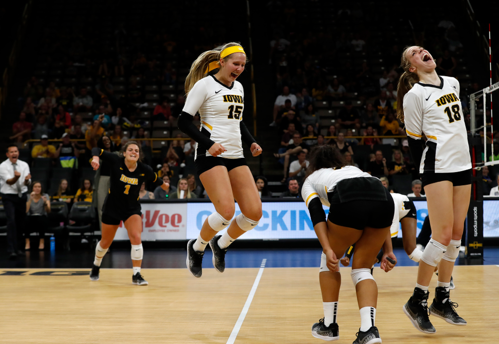 Iowa Hawkeyes defensive specialist Maddie Slagle (15) and middle blocker Hannah Clayton (18) against the Michigan Wolverines Sunday, September 23, 2018 at Carver-Hawkeye Arena. (Brian Ray/hawkeyesports.com)