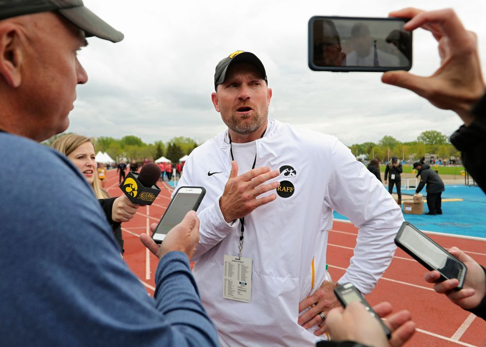 Iowa Director of Track and Field Joey Woody taps the Raff sticker on his shirt as he talks with reporters after winning the Men's Big Ten Outdoor Track and Field Championships on the third day of the Big Ten Outdoor Track and Field Championships at Francis X. Cretzmeyer Track in Iowa City on Sunday, May. 12, 2019. (Stephen Mally/hawkeyesports.com)