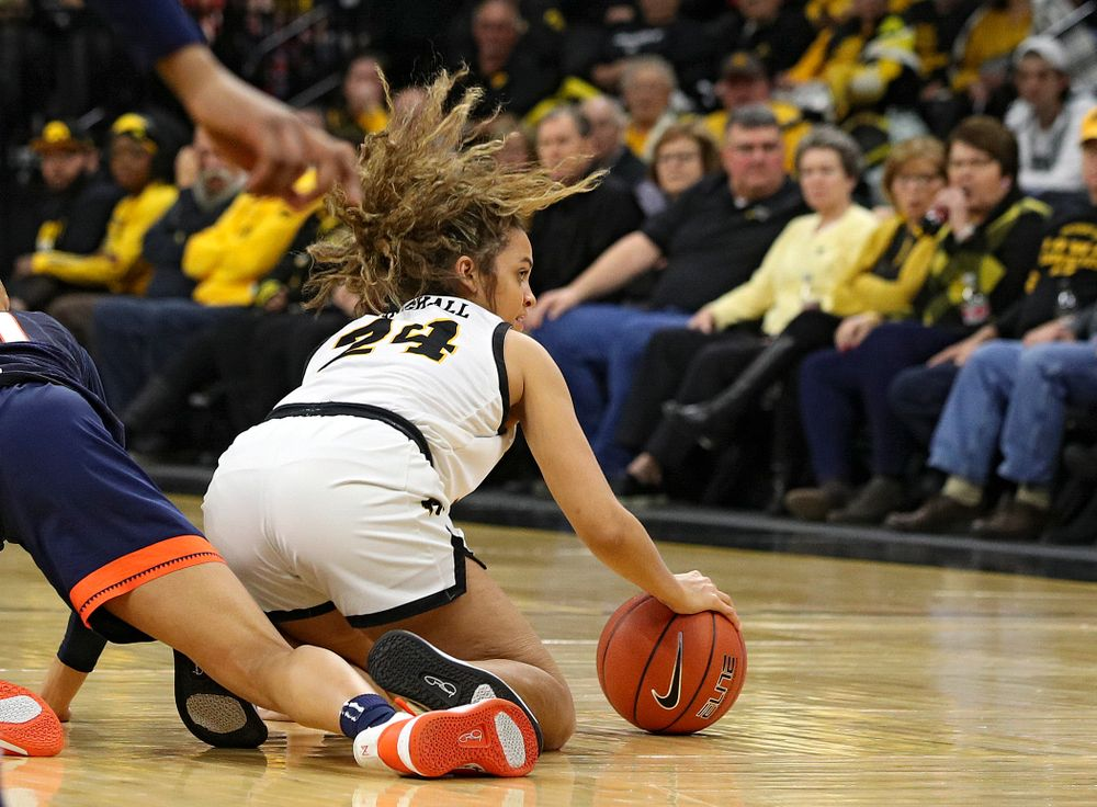Iowa Hawkeyes guard Gabbie Marshall (24) grabs a loose ball on the court during the second quarter of their game at Carver-Hawkeye Arena in Iowa City on Tuesday, December 31, 2019. (Stephen Mally/hawkeyesports.com)