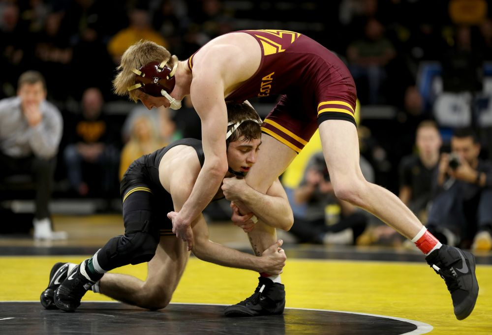 Iowa's Austin DeSanto wrestles Minnesota's Boo Dryden at 133 pounds Saturday, February 15, 2020 at Carver-Hawkeye Arena. DeSanto won the match 24-8. (Brian Ray/hawkeyesports.com)