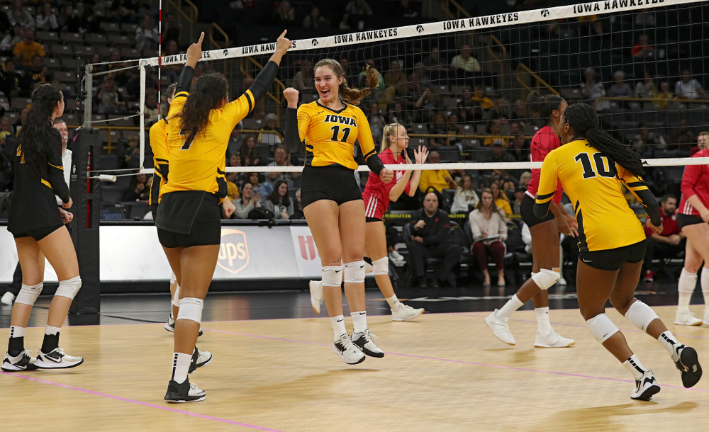 Iowa's Halle Johnston (4), Courtney Buzzerio (2), Brie Orr (7), Blythe Rients (11), and Griere Hughes (10) celebrate after a score during their match at Carver-Hawkeye Arena in Iowa City on Sunday, Oct 20, 2019. (Stephen Mally/hawkeyesports.com)