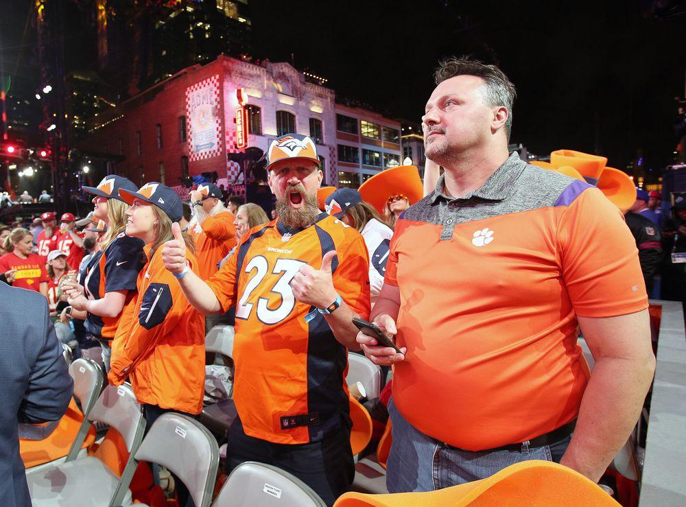 Broncos fans celebrate the selection of Noah Fant
