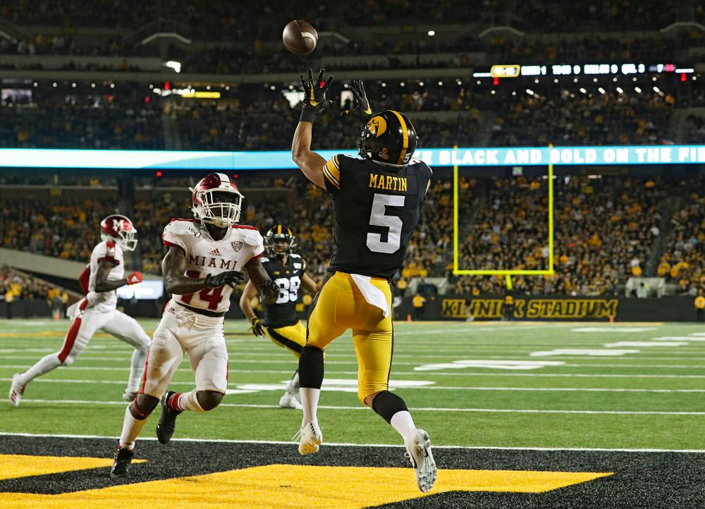 Iowa Hawkeyes wide receiver Oliver Martin (5) pulls in a 9-yard touchdown reception during the third quarter of their game at Kinnick Stadium in Iowa City on Saturday, Aug 31, 2019. (Stephen Mally/hawkeyesports.com)