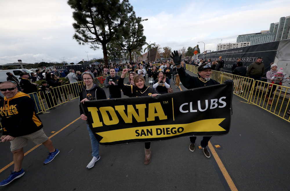 The San Diego Iowa Club marches in the Holiday Bowl Parade Thursday, December 26, 2019 in San Diego. (Brian Ray/hawkeyesports.com)
