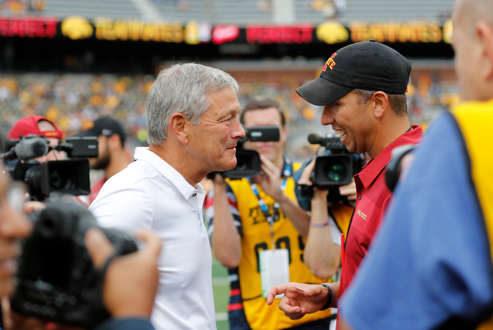 Iowa Hawkeyes head coach Kirk Ferentz  talks with Iowa State Cyclones head coach Matt Campbell before their game Saturday, September 8, 2018 at Kinnick Stadium. (Brian Ray/hawkeyesports.com)