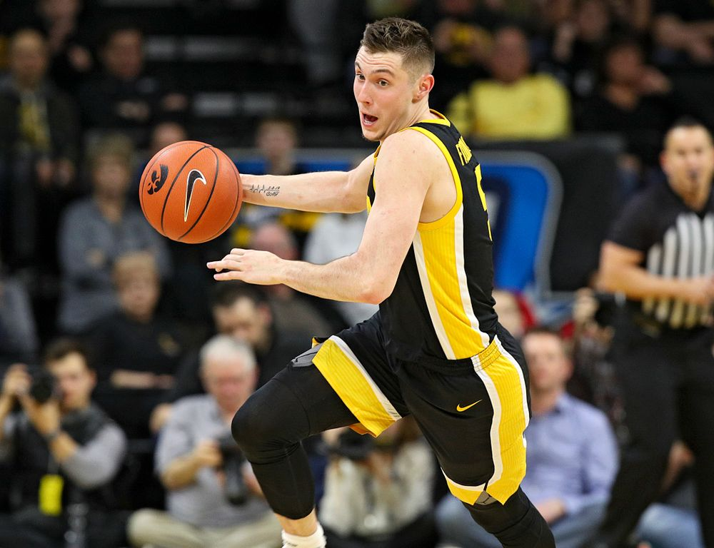 Iowa Hawkeyes guard CJ Fredrick (5) brings the ball down the floor during the first half of their game at Carver-Hawkeye Arena in Iowa City on Monday, January 27, 2020. (Stephen Mally/hawkeyesports.com)