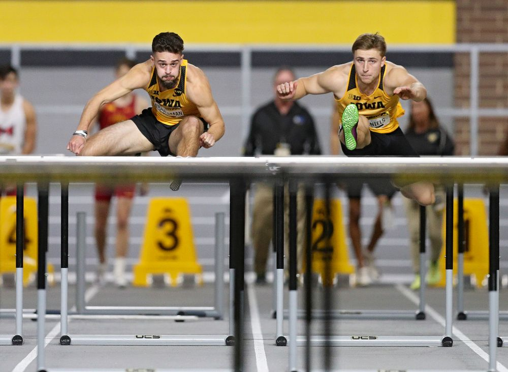 Iowa's Josh Braverman (from left) and Will Daniels compete in the men's 60 meter hurdles prelims event during the Jimmy Grant Invitational at the Recreation Building in Iowa City on Saturday, December 14, 2019. (Stephen Mally/hawkeyesports.com)