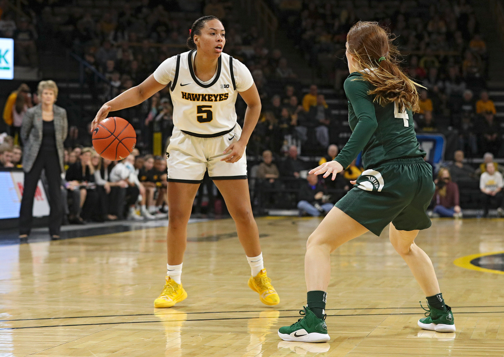 Iowa Hawkeyes guard Alexis Sevillian (5) dribbles the ball during the second quarter of their game at Carver-Hawkeye Arena in Iowa City on Sunday, January 26, 2020. (Stephen Mally/hawkeyesports.com)
