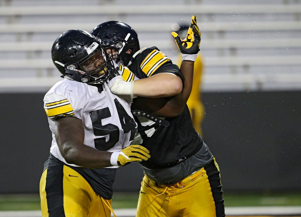 Iowa Hawkeyes defensive tackle Daviyon Nixon (54) and offensive lineman Tyler Endres (69) work on a drill during Fall Camp Practice No. 12 at Kinnick Stadium in Iowa City on Thursday, Aug 15, 2019. (Stephen Mally/hawkeyesports.com)