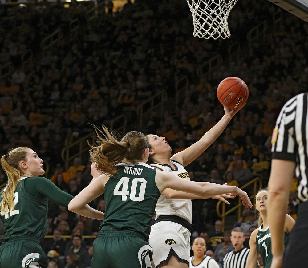 Iowa Hawkeyes guard Mckenna Warnock (14) scores a basket during the third quarter of their game at Carver-Hawkeye Arena in Iowa City on Sunday, January 26, 2020. (Stephen Mally/hawkeyesports.com)