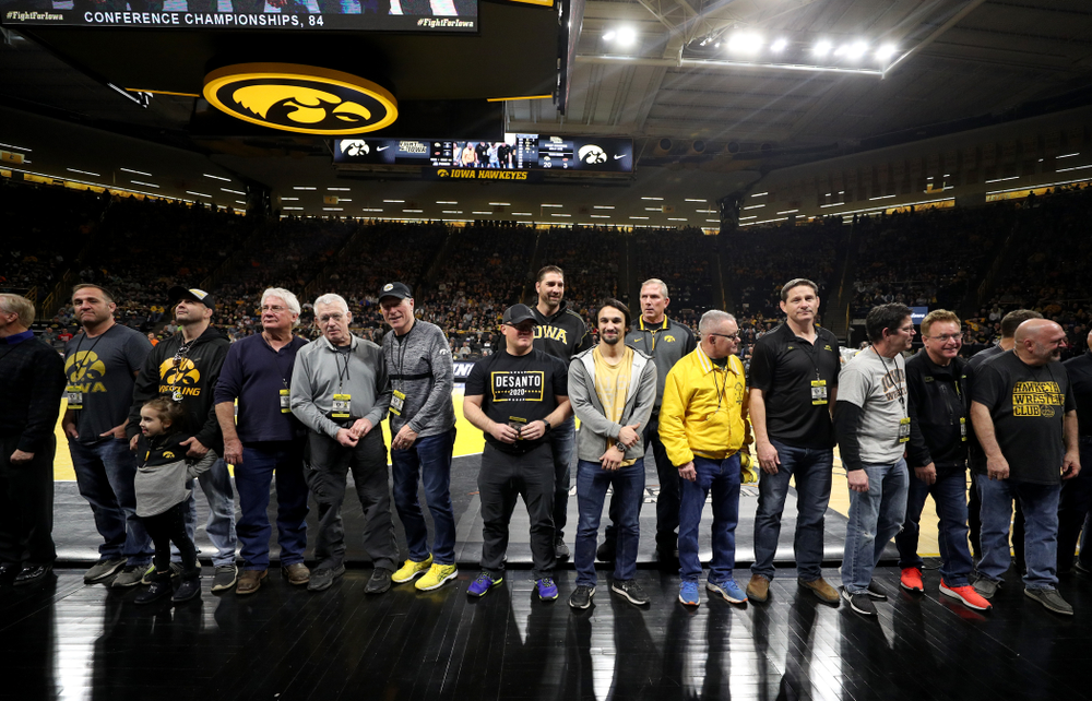 Legendary former head coach Dan Gable shakes hands with Iowa Wrestling alumni  during the Iowa Hawkeyes dual against Oklahoma State Sunday, February 23, 2020 at Carver-Hawkeye Arena. (Brian Ray/hawkeyesports.com)
