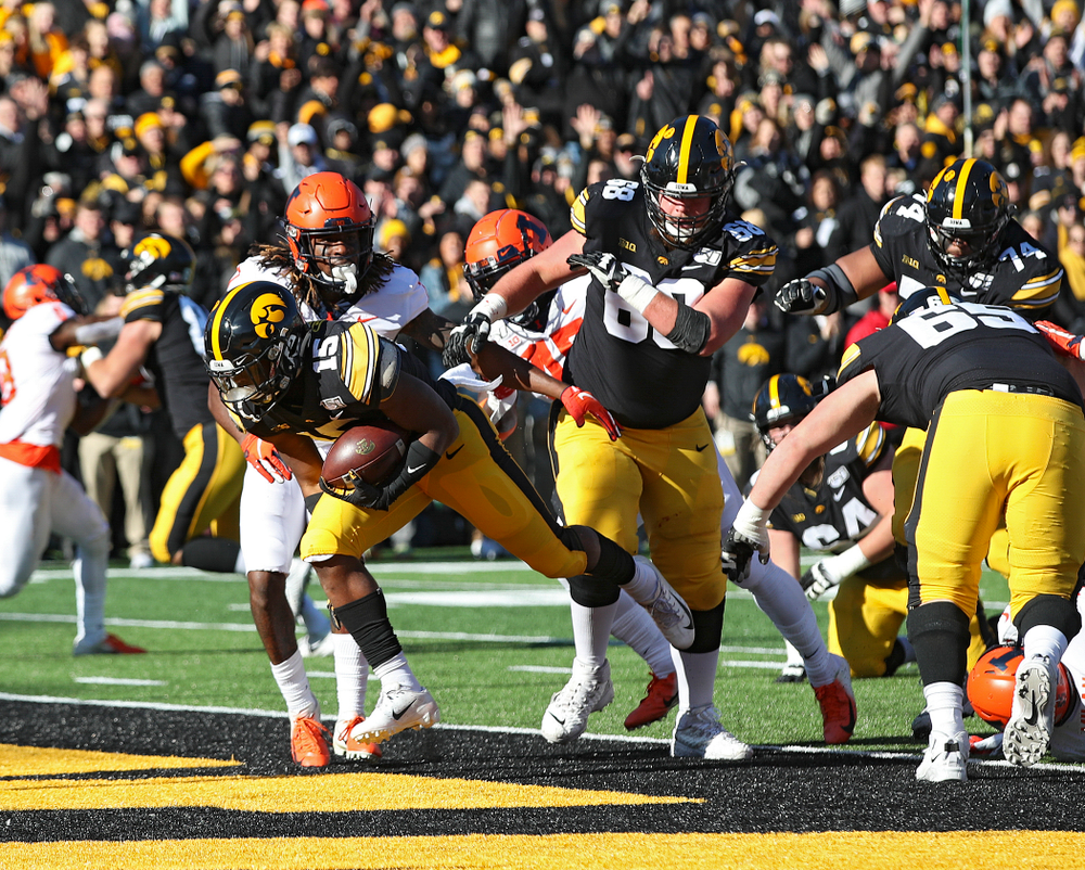 Iowa Hawkeyes running back Tyler Goodson (15) scores a touchdown during the first quarter of their game at Kinnick Stadium in Iowa City on Saturday, Nov 23, 2019. (Stephen Mally/hawkeyesports.com)