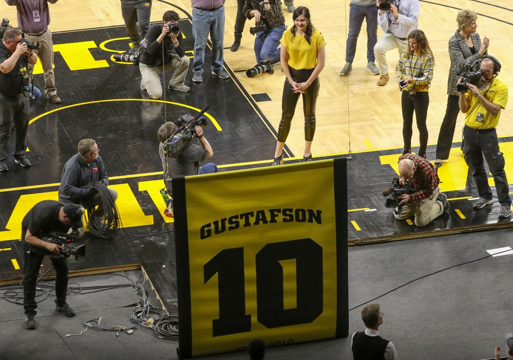 Megan Gustafson watches as her number is raised to the rafters during her jersey retirement ceremony at Carver-Hawkeye Arena in Iowa City on Sunday, January 26, 2020. (Stephen Mally/hawkeyesports.com)