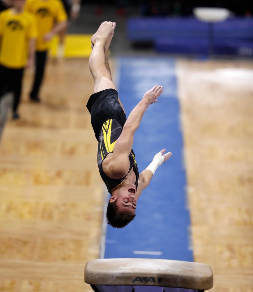 Mitch Mandozzi competes on the vault against Illinois