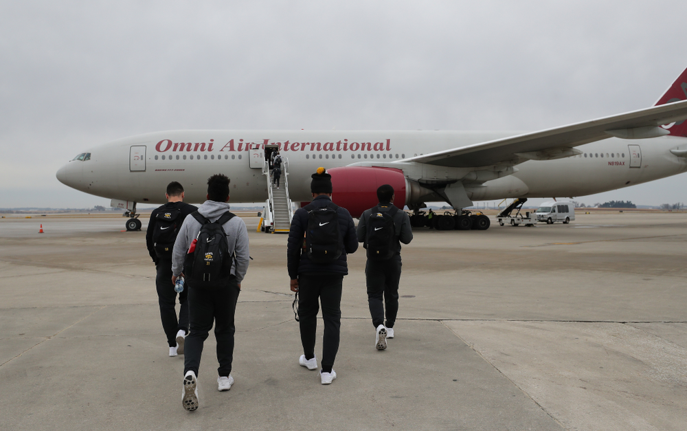 The Iowa Hawkeyes board the team plane Wednesday, December 26, 2018 as they travel to Tampa, Florida for the Outback Bowl. (Brian Ray/hawkeyesports.com)