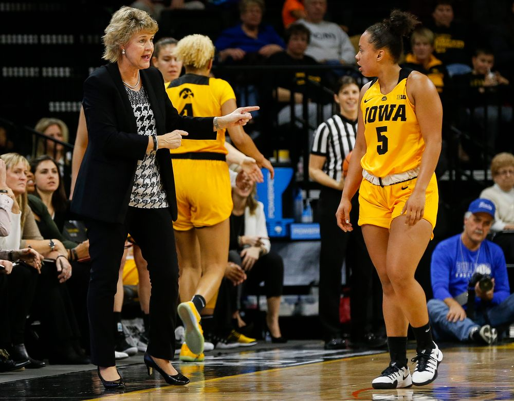Iowa Hawkeyes head coach Lisa Bluder, Iowa Hawkeyes guard Alexis Sevillian (5)