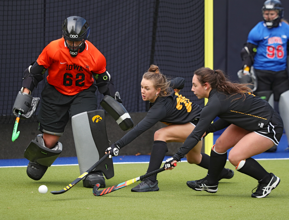 Iowa's Maddy Murphy (26) tries to reach a ball between Grace McGuire (62) and Amy Gaiero (1) during their practice at Karen Shelton Stadium in Chapel Hill, N.C. on Saturday, Nov 16, 2019. (Stephen Mally/hawkeyesports.com)