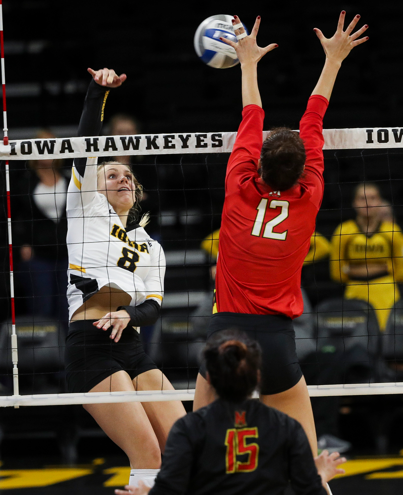 Iowa Hawkeyes right side hitter Reghan Coyle (8) spikes the ball during a match against Maryland at Carver-Hawkeye Arena on November 23, 2018. (Tork Mason/hawkeyesports.com)