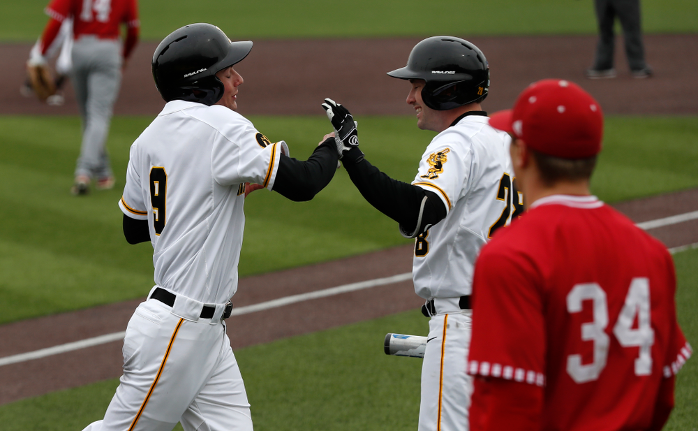 Iowa Hawkeyes outfielder Ben Norman (9) and infielder Chris Whelan (28) during a double header against the Indiana Hoosiers Friday, March 23, 2018 at Duane Banks Field. (Brian Ray/hawkeyesports.com)