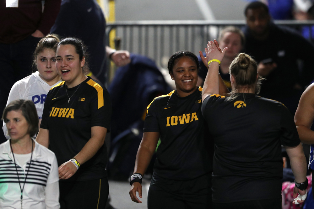 Iowa's Nia Britt high fives Erika Hammond as they compete  in the Shot Put during the Black and Gold Premier meet Saturday, January 26, 2019 at the Recreation Building. (Brian Ray/hawkeyesports.com)