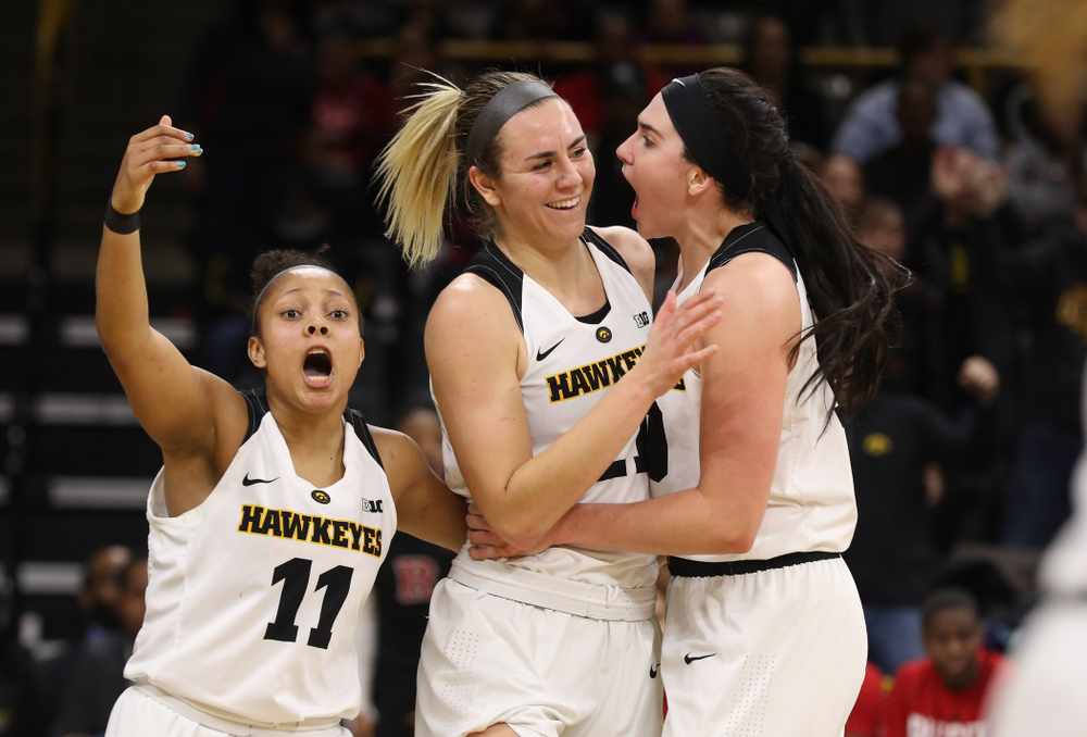Iowa Hawkeyes forward Hannah Stewart (21) celebrates with forward Megan Gustafson (10) and guard Tania Davis (11) after getting a block and a steal late in the game against the Rutgers Scarlet Knights Wednesday, January 23, 2019 at Carver-Hawkeye Arena. (Brian Ray/hawkeyesports.com)