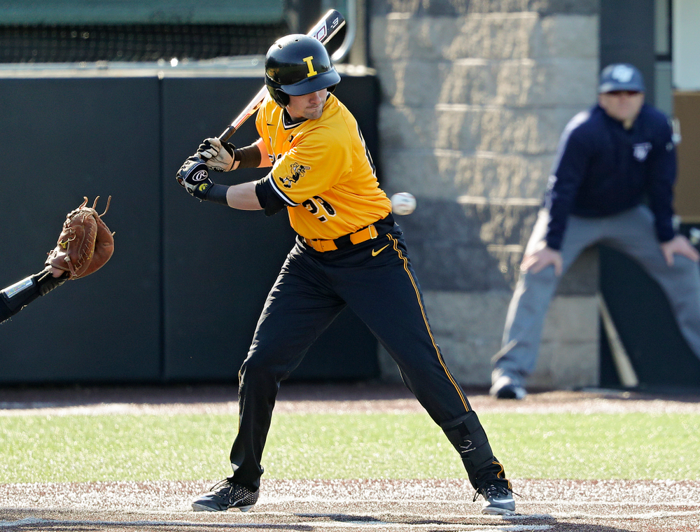 Iowa Hawkeyes left fielder Chris Whelan (28) is hit by a pitch during the second inning of their game at Duane Banks Field in Iowa City on Tuesday, Apr. 2, 2019. (Stephen Mally/hawkeyesports.com)