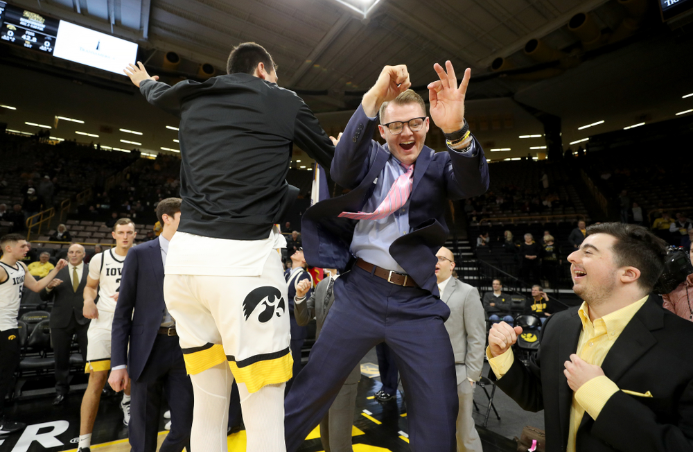 Iowa Hawkeyes forward Ryan Kriener (15) and manager Lucas Pauley against North Florida Thursday, November 21, 2019 at Carver-Hawkeye Arena. (Brian Ray/hawkeyesports.com)