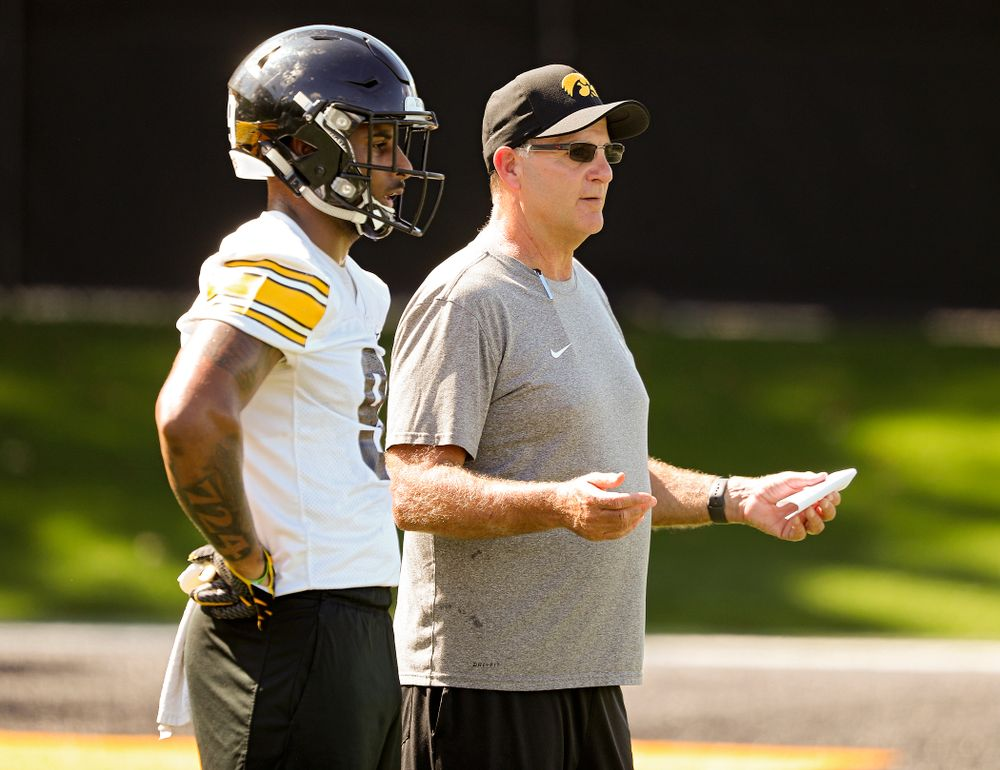 Iowa Hawkeyes defensive back Geno Stone (9) talks with defensive coordinator Phil Parker during Fall Camp Practice No. 13 at the Hansen Football Performance Center in Iowa City on Friday, Aug 16, 2019. (Stephen Mally/hawkeyesports.com)