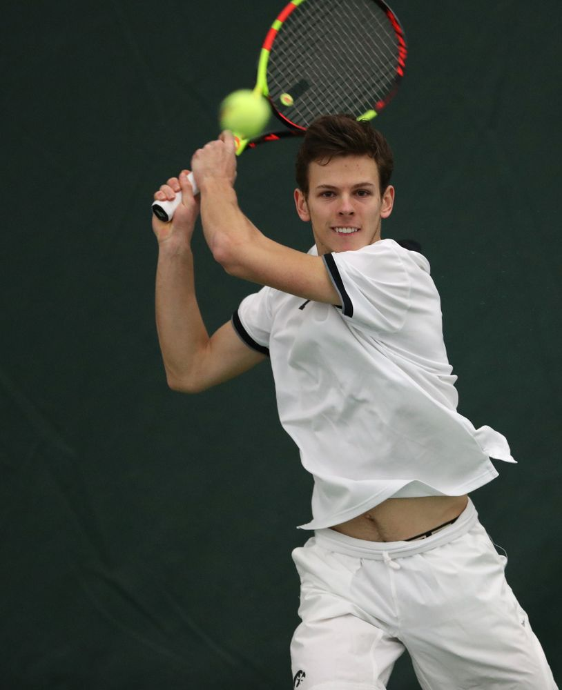 Iowa's Piotr Smietana against North Dakota Friday, January 25, 2019 at the Hawkeye Tennis and Recreation Complex. (Brian Ray/hawkeyesports.com)