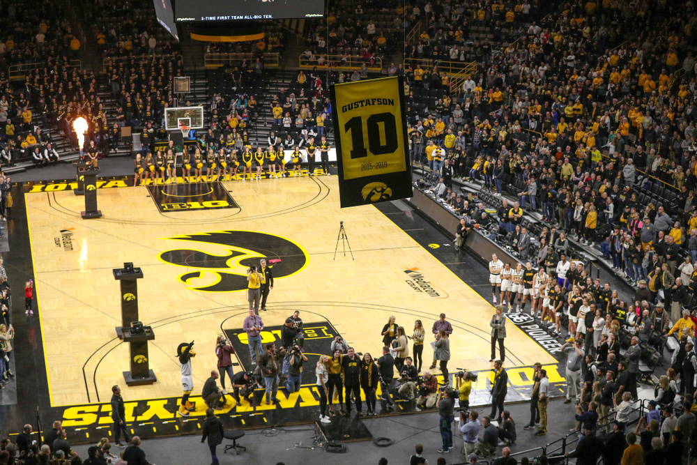Fans watch with Megan Gustafson as her number is raised to the rafters during her jersey retirement ceremony at Carver-Hawkeye Arena in Iowa City on Sunday, January 26, 2020. (Stephen Mally/hawkeyesports.com)