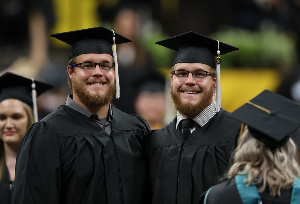Hawkeye FootballÕs Landan and Levi Paulsen during the College of Liberal Arts and Sciences spring commencement Saturday, May 11, 2019 at Carver-Hawkeye Arena. (Brian Ray/hawkeyesports.com)