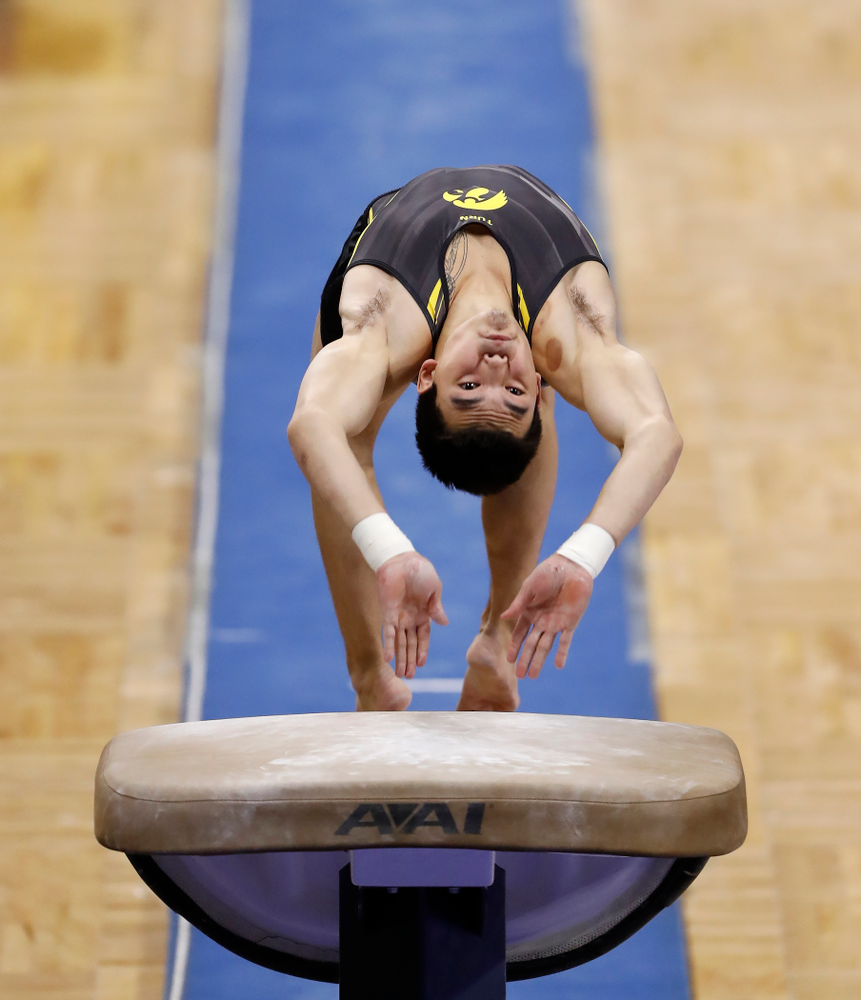 Addison Chung competes on the vault against Illinois