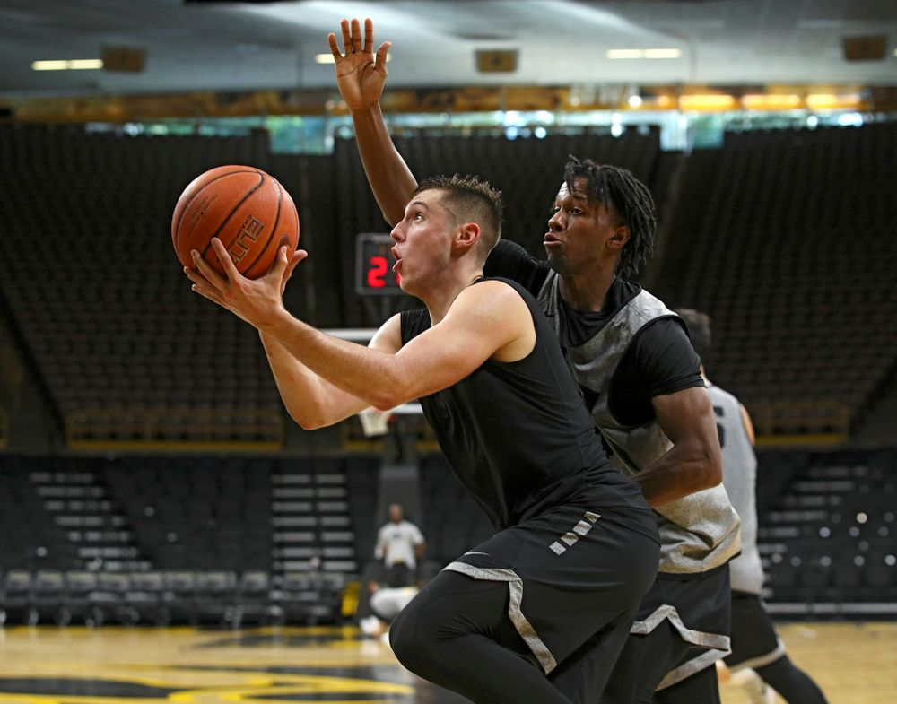 Iowa Hawkeyes guard CJ Fredrick (5) drives to the basket as guard Bakari Evelyn (4) defends during practice at Carver-Hawkeye Arena in Iowa City on Monday, Sep 30, 2019. (Stephen Mally/hawkeyesports.com)