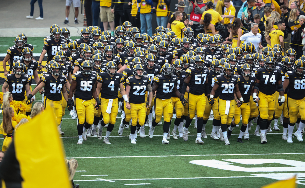 The Iowa Hawkeyes swarm onto the field for their game against Middle Tennessee State Saturday, September 28, 2019 at Kinnick Stadium. (Max Allen/hawkeyesports.com)