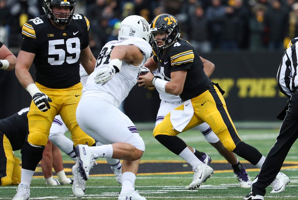 Iowa Hawkeyes quarterback Nate Stanley (4) scrambles during a game against Northwestern at Kinnick Stadium on November 10, 2018. (Tork Mason/hawkeyesports.com)