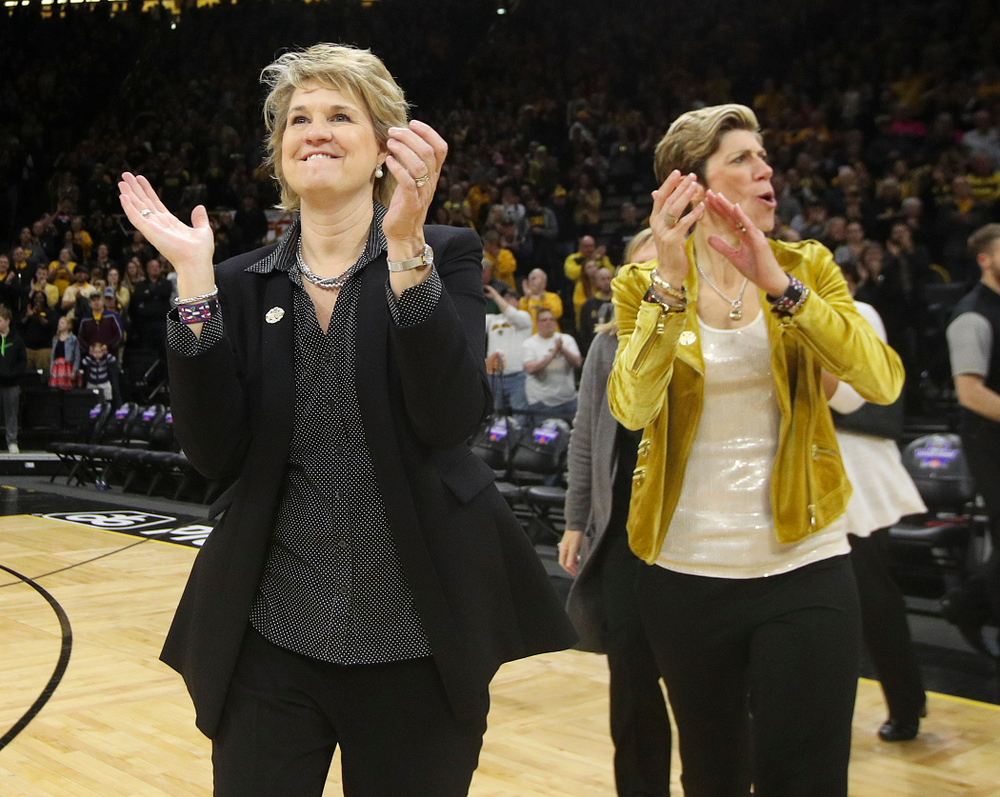 Iowa Hawkeyes head coach Lisa Bluder and associate head coach Jan Jensen clap after winning their second round game in the 2019 NCAA Women's Basketball Tournament at Carver Hawkeye Arena in Iowa City on Sunday, Mar. 24, 2019. (Stephen Mally for hawkeyesports.com)
