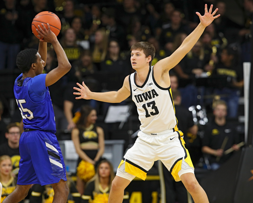 Iowa Hawkeyes guard Austin Ash (13) defends during the second half of their exhibition game against Lindsey Wilson College at Carver-Hawkeye Arena in Iowa City on Monday, Nov 4, 2019. (Stephen Mally/hawkeyesports.com)
