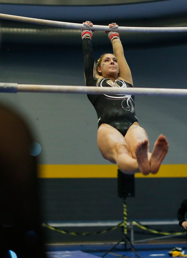 Emma Hartzler competes on the uneven bars during the Black and Gold Intrasquad meet at the Field House on 12/2/17. (Tork Mason/hawkeyesports.com)
