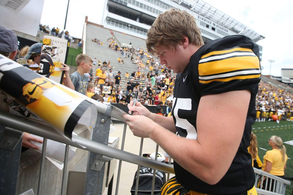 Iowa Hawkeyes fullback Joe Ludwig (45) signs autographs during Kids Day at Kinnick Stadium on Saturday, August 10, 2019. (Lily Smith/hawkeyesports.com)