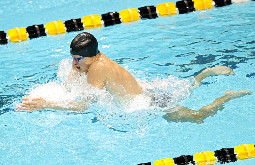 Iowa's Anze Fers Erzen swims the men's 100 yard individual medley event during their meet at the Campus Recreation and Wellness Center in Iowa City on Friday, February 7, 2020. (Stephen Mally/hawkeyesports.com)