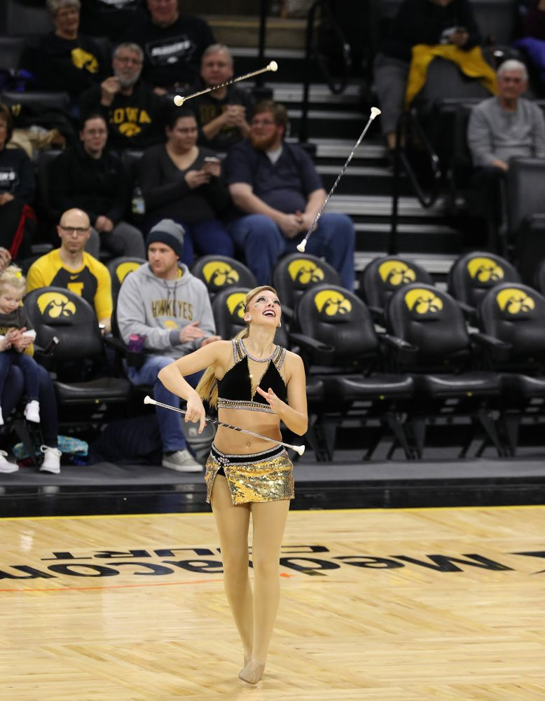 Hawkeye Marching Band Golden Girl Kylene Spanbauer against the Michigan Wolverines Thursday, January 17, 2019 at Carver-Hawkeye Arena. (Brian Ray/hawkeyesports.com)