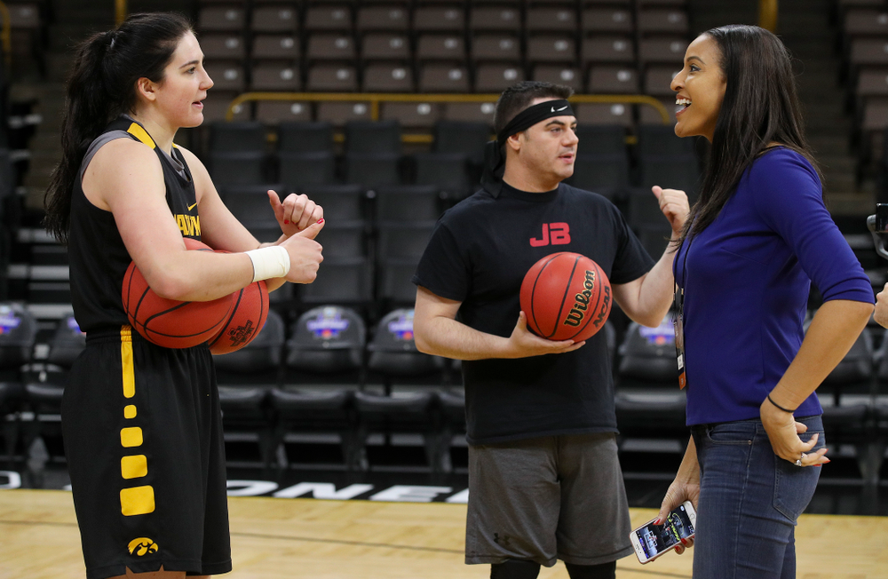 Iowa Hawkeyes forward Megan Gustafson (10), John Brickley, play- by-play for ESPN, and Christy Winters Scott, analyst for ESPN, talk together at a practice during the 2019 NCAA Women's Basketball Tournament at Carver Hawkeye Arena in Iowa City on Saturday, Mar. 23, 2019. (Stephen Mally for hawkeyesports.com)