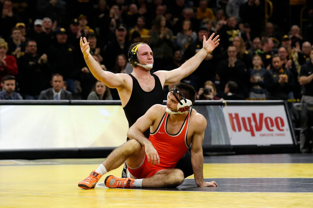 Iowa's Alex Marinelli defeats Oklahoma State's Chandler Rogers at 174 pounds Rogers at 174 pounds