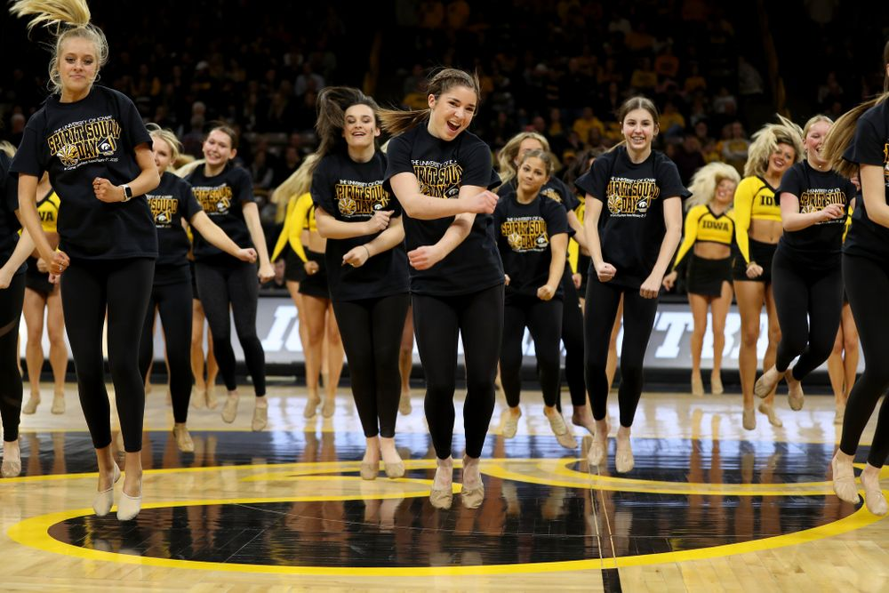 The Iowa Spirit Squad performs with participants in Spirit Squad Day at halftime of the Iowa Hawkeyes game against the Nebraska Cornhuskers Saturday, February 8, 2020 at Carver-Hawkeye Arena. (Brian Ray/hawkeyesports.com)