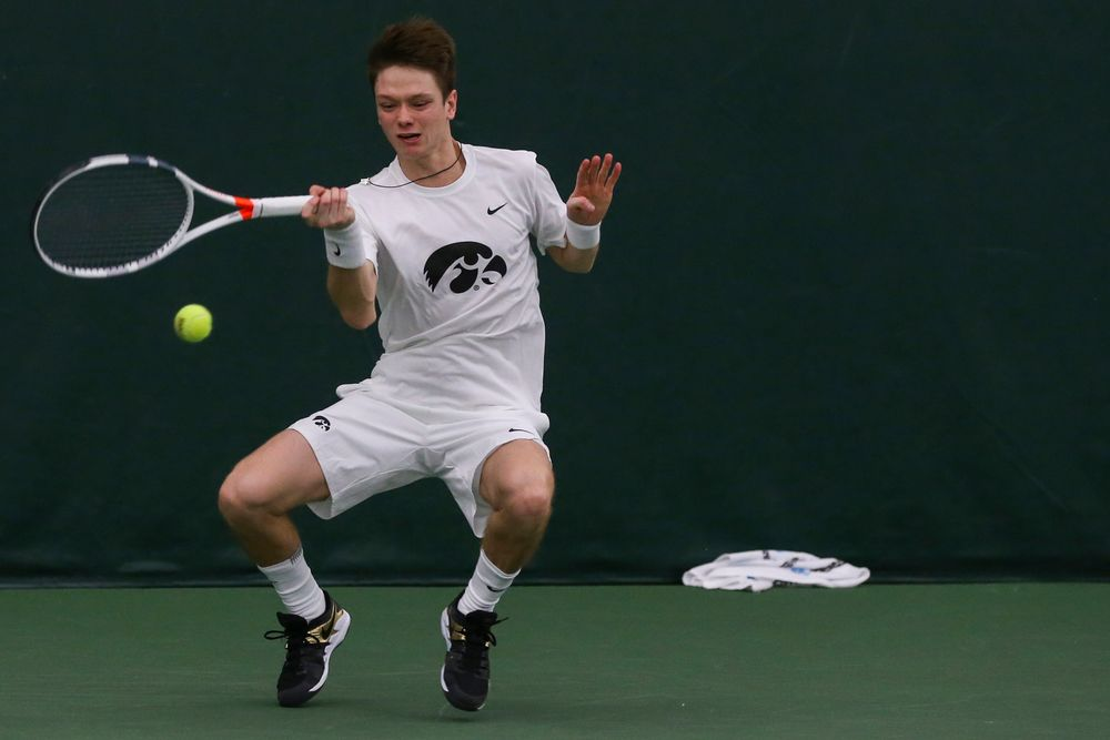 Iowa's Jason Kerst hits a forehand during the Iowa men's tennis match vs Western Michigan on Saturday, January 18, 2020 at the Hawkeye Tennis and Recreation Complex. (Lily Smith/hawkeyesports.com)