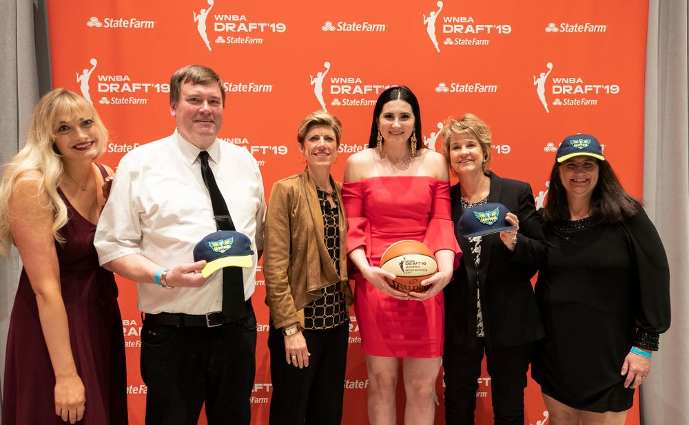 Iowa Hawkeyes forward Megan Gustafson (10) with head coach Lisa Bluder, associate head coach Jan Jensen and her family after being selected by the Dallas Wings in the second round of the 2019 WNBA Draft Wednesday, April 10, 2019 at Nike New York Headquarters in New York City. (Brian Ray/hawkeyesports.com)