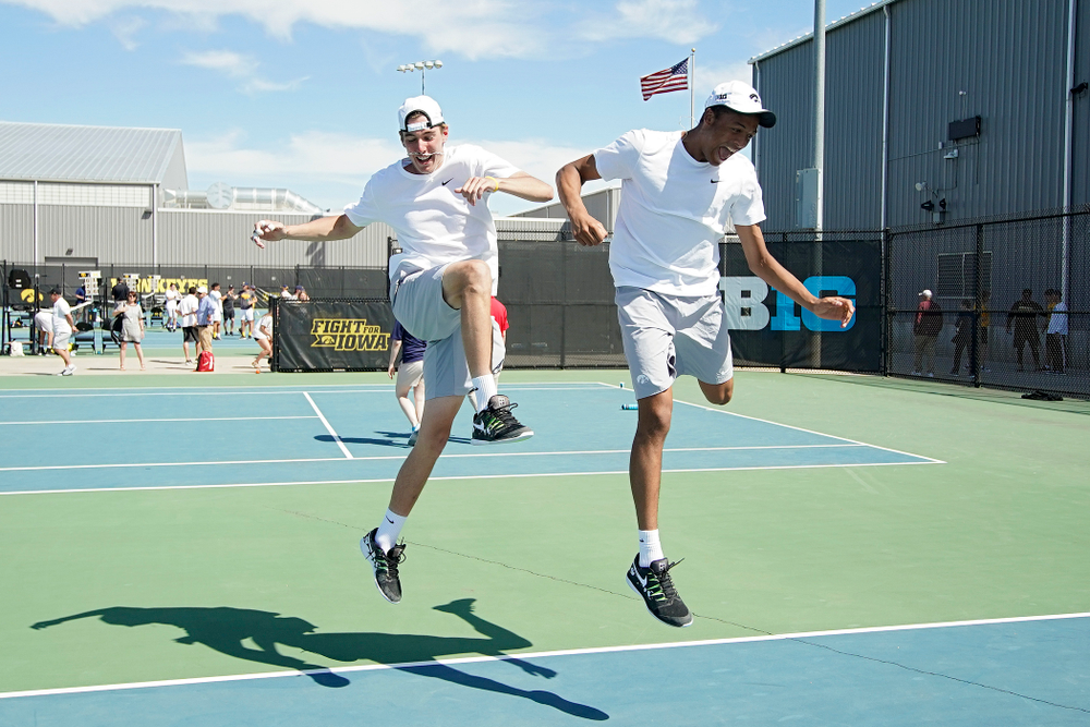 Iowa's Nakita Snezhko (from left) and Oliver Okonkwo celebrate after winning their match against Michigan at the Hawkeye Tennis and Recreation Complex in Iowa City on Sunday, Apr. 21, 2019. (Stephen Mally/hawkeyesports.com)