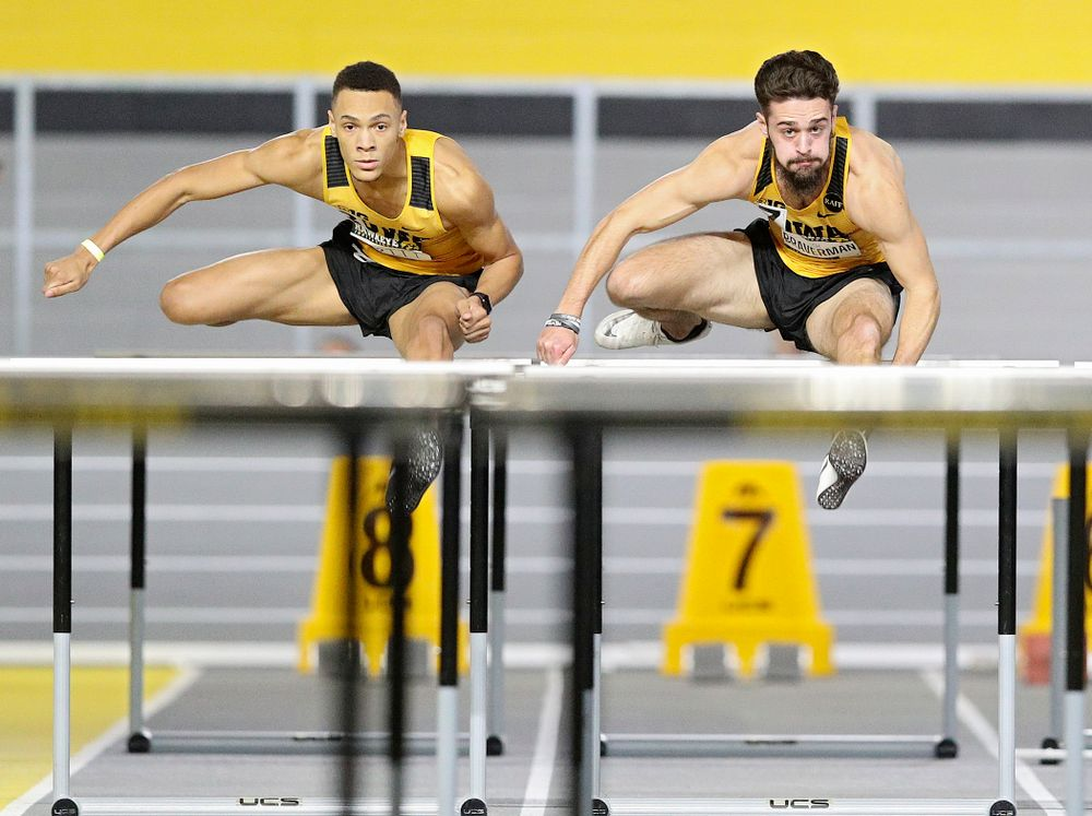 Iowa's Jamal Britt (from left) and Josh Braverman run in the men's 60 meter hurdles prelim event during the Hawkeye Invitational at the Recreation Building in Iowa City on Saturday, January 11, 2020. (Stephen Mally/hawkeyesports.com)