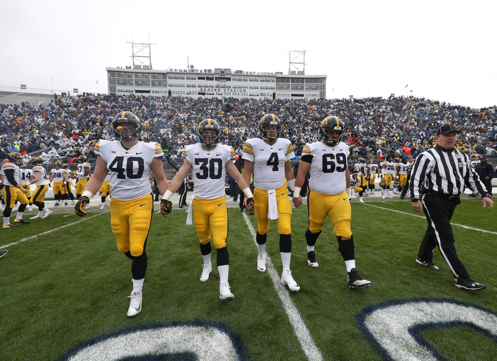 Iowa Hawkeyes captains defensive end Parker Hesse (40), defensive back Jake Gervase (30), quarterback Nate Stanley (4), and offensive lineman Keegan Render (69) against the Penn State Nittany Lions Saturday, October 27, 2018 at Beaver Stadium in University Park, Pa. (Brian Ray/hawkeyesports.com)