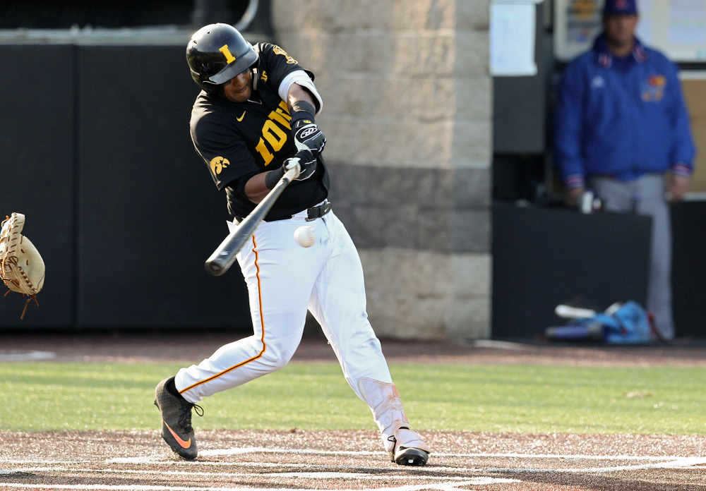 Iowa infielder Izaya Fullard (20) drives a pitch for a hit during the third inning of their college baseball game at Duane Banks Field in Iowa City on Tuesday, March 10, 2020. (Stephen Mally/hawkeyesports.com)